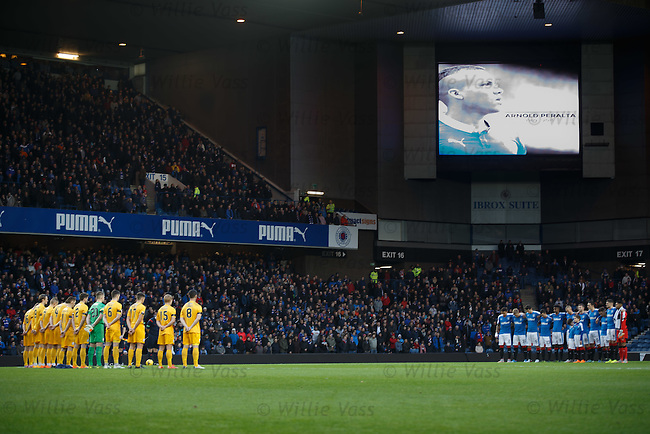 The Morton and Rangers squads observe a minutes silence for Arnold Peralta