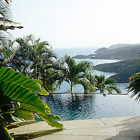 The outdoor infinity pool has spectacular view of the Mustique coastline