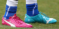 CAPTION CORRECTION The personalised odd coloured Puma football boots of Mario Balotelli of Italy with 'Super M. Angel' stitched into them
