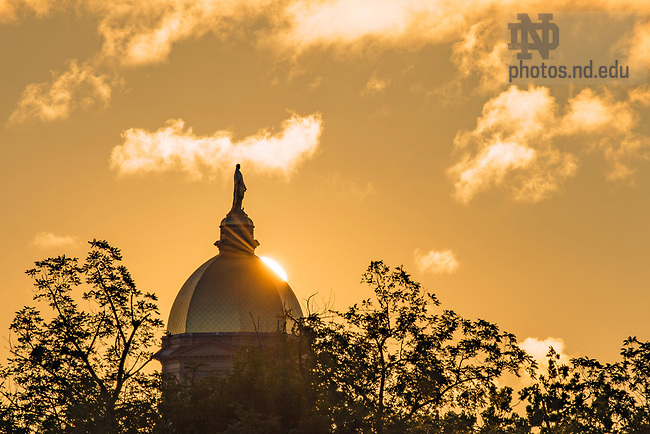 July 24, 2017; Sun rises behind the Dome. (Photo by Matt Cashore/University of Notre Dame)