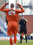 24.3.2018: Rangers legends match:<br /> Ref John McKendrick playing for laughs as he can't see an obvious foul