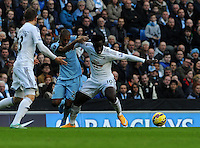 Picture: Andrew Roe/AHPIX LTD, Football, Barclays Premier League, Manchester City v Swansea City, 22/11/14, Etihad Stadium, K.O 3pm<br /> <br /> City's Fernandinho tussles with Swansea's Wilfried Bony<br /> <br /> Andrew Roe>>>>>>>07826527594