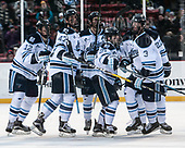Chase Pearson (Maine - 12), Mark Hamilton (Maine - 47), Cam Brown (Maine - 21), Rob Michel (Maine - 3), Brendan Robbins (Maine - 22) (glass reflection) - The University of Maine Black Bears defeated the University of Connecticut Huskies 4-0 at Fenway Park on Saturday, January 14, 2017, in Boston, Massachusetts.