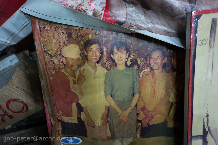 moustache brothers and Suu Kyi on photos, stage decoration of Moustache brothers,   Mandalay, Myanmar, 2011. A-nyeint is a form of vaudeville folk opera with dance, music, jokes and satire.