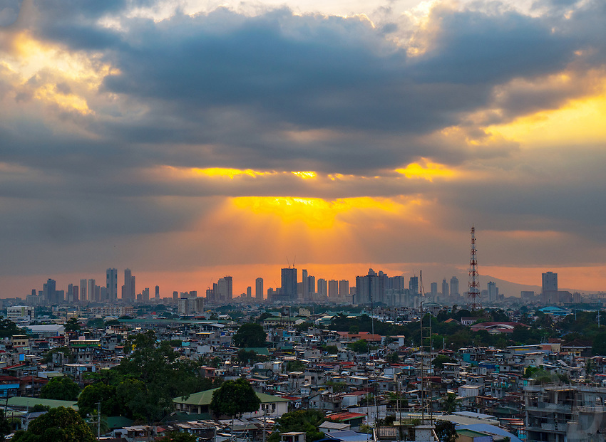 Panoramic Manila Skyline Sunset over Manila, with squatter area in the foreground