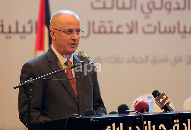 Palestinian Prime Minister, Rami Hamdallah, attends Third International Conference of prisoners, in the West Bank city of Ramallah, on March 15, 2017. Photo by Prime Minister Office