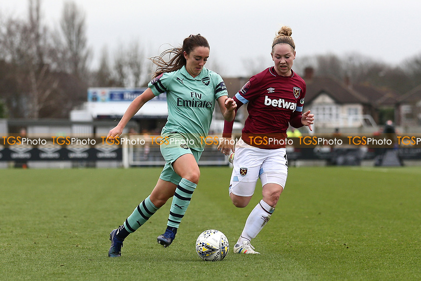 Lisa Evans of Arsenal and Lucienne Reichardt of West Ham during West Ham United Women vs Arsenal Women, FA Women's Super League Football at Rush Green Stadium on 6th January 2019