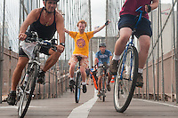 Brooklyn, NY -  3 September 2010 - Unicyclists and bicyclists cross the Brooklyn Bridge enroute to Coney Island during the Brooklyn Long Distance Unicycle Ride.