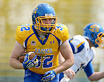 BROOKINGS, SD - APRIL 26:  Kyle Paris #32 from South Dakota State's offense looks for running room during their spring game Saturday at Coughlin Alumni Stadium in Brookings. (Photo by Dave Eggen/Inertia)