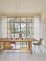 A leaded glass wall floods the dining area with light and gives it great views over the garden