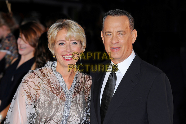 Emma Thompson and Tom Hanks<br /> attending the 57th BFI London Film Festival Closing Night Gala World Premiere of 'Saving Mr Banks', Odeon Cinema, Leicester Square, London, England. <br /> 20th October 2013<br /> half length black suit tie white shirt beige white pattern blouse top<br /> CAP/MAR<br /> &copy; Martin Harris/Capital Pictures