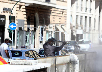 Workers clean the streets in central Rome on May 4, 2020 as Italy starts to ease its lockdown, during the countrys lockdown aimed at curbing the spread of the COVID-19 infection, caused by the novel coronavirus.<br /> UPDATE IMAGES PRESS/Isabella Bonotto