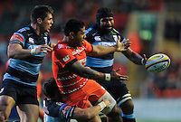 Manu Tuilagi offloads the ball after being tackled. Pre-season friendly match, between Leicester Tigers and Cardiff Blues on August 29, 2014 at Welford Road in Leicester, England. Photo by: Patrick Khachfe / JMP