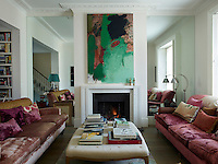 The walls on either side of the fireplace in the front half of the double sitting room are mirrored enhancing the sense of light and space