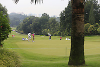 Play on the 3rd green during Round 3 of the CIMB Classic in the Kuala Lumpur Golf & Country Club on Saturday 1st November 2014.<br /> Picture:  Thos Caffrey / www.golffile.ie