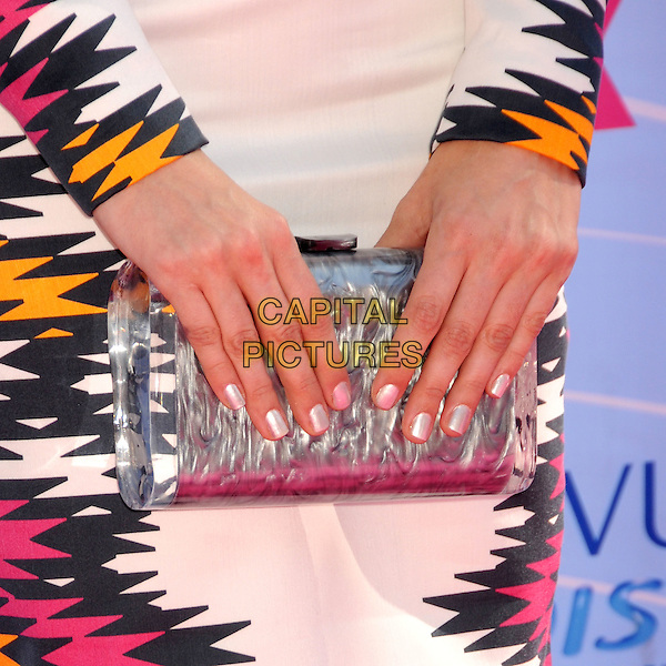 Debby Ryan's bag.FOX's 2012 Teen Choice Awards held at The Gibson Ampitheatre in Universal City, California, USA..July 22nd, 2012.hands nail varnish polish metallic white black pink orange print clutch bag silver .CAP/ADM/BP.©Byron Purvis/AdMedia/Capital Pictures.