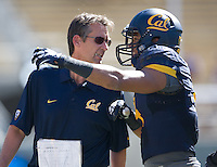 California special team coach Mark Tommerdahl talks with his player during the game against Washington State at Memorial Stadium in Berkeley, California on October 5th, 2013.  Washington State defeated California, 44-22.