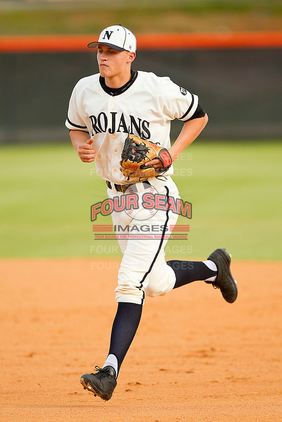 Northwest Cabarrus Trojans shortstop Corey Seager #9 runs off the field during the game against the Sun Valley Spartans on March 7, 2012 in Kannapolis, North Carolina.  (Brian Westerholt/Four Seam Images)