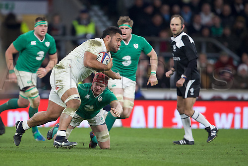 27.02.2016. Twickenham, London, England. RBS Six Nations Championships. England versus Ireland. England number 8 Billy Vunipola is tackled by Ireland flanker Josh van der Flier.