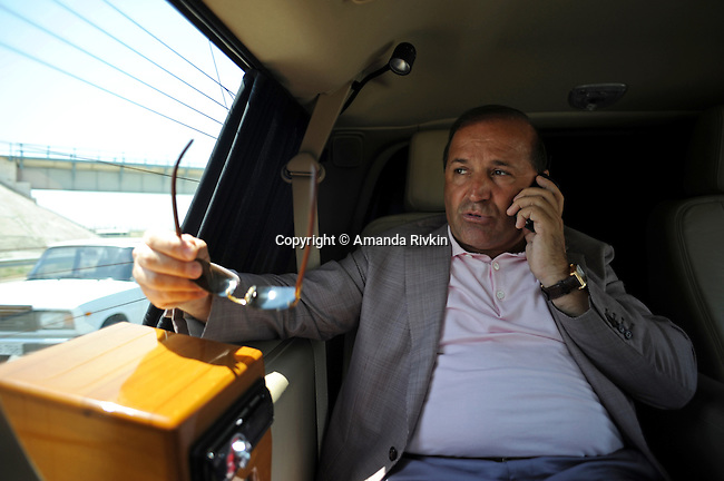 Ibrahim Ibrahimov, an Azerbaijani oligarch and billionaire, talks on his cellphone after a visit to the site of the Khazar Islands on the drive between Sahil and Baku, Azerbaijan on July 18, 2012.  The brainchild of Ibrahimov, the artificial Khazar Islands project just southwest of the Azerbaijani capital Baku is being built at a projected cost of $100 billion with an anticipated 800,000 housing units.