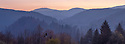 Looking across the forests of Plitvice Lakes National Park at dusk, Croatia. November. Digitally stitched panorama.