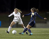 "West Virginia defender Meghan Lewis (12) passes as Boston College forward Stephanie Wirth (22) defends. Boston College defeated West Virginia, 4-0, in NCAA tournament ""Sweet 16"" match at Newton Soccer Field, Newton, MA."
