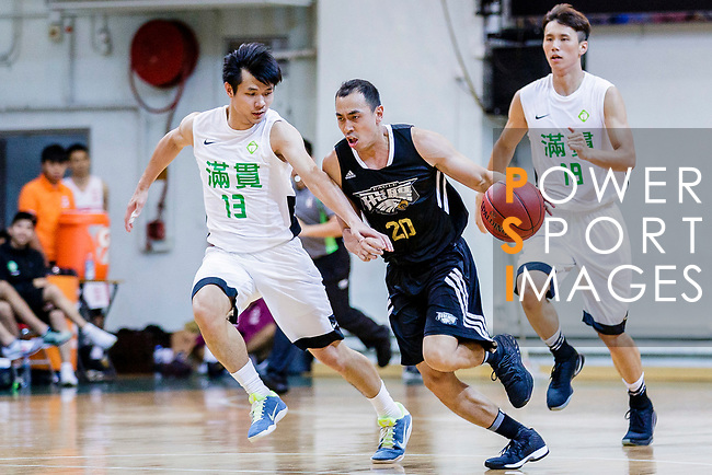 Chan Chai Chun #20 of Eagle Basketball Team dribbles the ball up court against Cheung Chi Hang #13 of Tycoon Basketball Team during the Hong Kong Basketball League game between Tycoon vs Eagle at Southorn Stadium on May 11, 2018 in Hong Kong. Photo by Yu Chun Christopher Wong / Power Sport Images