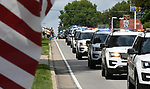 The procession approaches Quernheim Funeral Home after passing by Waterloo City Hall. Dozens of police departments joined in the procession from St. Louis to Waterloo for slain Illinois State Police Trooper Nick Hopkins on Monday August 26, 2019. <br /> Photo by Tim Vizer