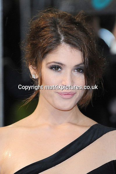 NON EXCLUSIVE PICTURE: PAUL TREADWAY / MATRIXPICTURES.CO.UK.PLEASE CREDIT ALL USES..WORLD RIGHTS..English actress Gemma Arterton attending the 2013 EE British Academy Film Awards, at London's Royal Opera House...FEBRUARY 10th 2013..REF: PTY 13945
