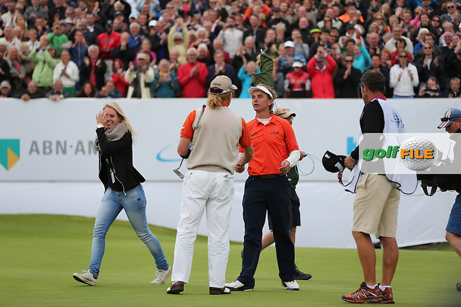 Joost Luiten (NED) wins the KLM Dutch Open and shakes hands with Miguel Angel Jimenez (ESP) who loses on a play-off, from the Kennemer Golf & Country Club, Zandvoort, Netherlands. Picture:  David Lloyd / www.golffile.ie