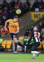 Wolverhampton Wanderers' Leander Dendoncker heads the ball back to his keeper under pressure from Newcastle United's Miguel Almiron<br /> Photographer Lee Parker/CameraSport<br /> <br /> The Premier League - Wolverhampton Wanderers v Newcastle United - Saturday 11th January 2020 - Molineux - Wolverhampton<br /> <br /> World Copyright © 2020 CameraSport. All rights reserved. 43 Linden Ave. Countesthorpe. Leicester. England. LE8 5PG - Tel: +44 (0) 116 277 4147 - admin@camerasport.com - www.camerasport.com