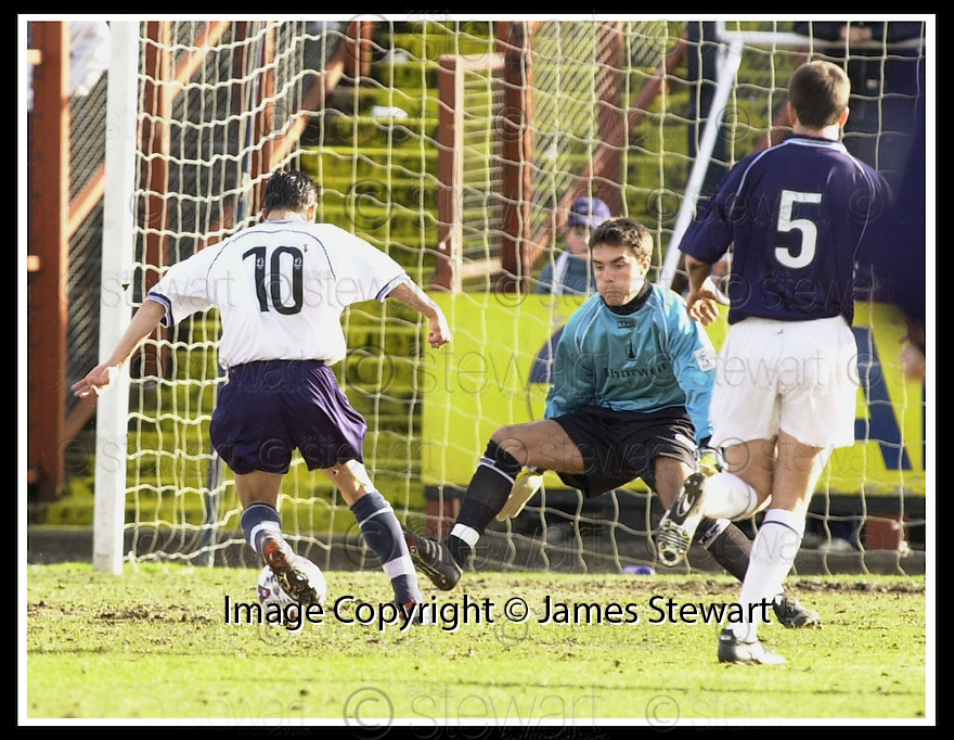 10/03/2002                 Copyright Pic : James Stewart .Ref :     .File Name : stewart-falkirk v raith 21.FALKIRK'S ROOKIE KEEPER DARREN HILL SAVES AT THE FEET OF NACHO NOVO.......James Stewart Photo Agency, Stewart House, Stewart Road, Falkirk. FK2 7AS      Vat Reg No. 607 6932 25.Office     : +44 (0)1324 630007     .Mobile  : + 44 (0)7721 416997.Fax         :  +44 (0)1324 630007.E-mail  :  jim@jspa.co.uk.If you require further information then contact Jim Stewart on any of the numbers above.........