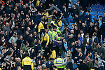 Some fans shake hands at full time whilst others hurl abuse during the Barclays Premier League match at the Etihad Stadium. Photo credit should read: Philip Oldham/Sportimage