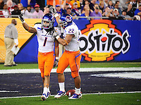 Jan. 4, 2010; Glendale, AZ, USA; Boise State Broncos cornerback (1) Kyle Wilson celebrates a play with running back (22) Doug Martin against the TCU Horned Frogs in the 2010 Fiesta Bowl at University of Phoenix Stadium. Boise State defeated TCU 17-10. Mandatory Credit: Mark J. Rebilas-