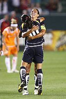 Shannon Boxx #7 and Marta #10 of the Los Angeles Sol celebrate a goal against Sky Blue FC during their WPS game at Home Depot Center on May 15, 2009 in Carson, California.