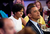 Washington, DC - July 21, 2009 -- United States President Barack Obama and First Lady Michelle Obama are pictured at an event celebrating country music in the East Room of the White House in Washington DC, USA on 21 July 2009. Artists scheduled to perform included Charley Pride, Brad Paisley and Alison Krauss and Union Station. .Credit: Matthew Cavanaugh / Pool via CNP