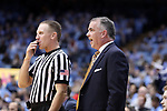 CHAPEL HILL, NC - DECEMBER 20: Wofford head coach Mike Young talks to referee Mike Eades. The University of North Carolina Tar Heels hosted the Wofford College Terriers on December 20, 2017 at Dean E. Smith Center in Chapel Hill, NC in a Division I men's college basketball game. Wofford won the game, upsetting UNC, 79-75.