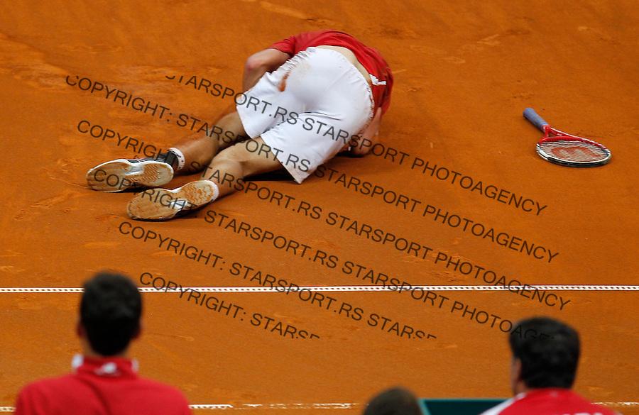 Tennis Tenis<br /> Davis Cup semifinal polufinale<br /> Serbia v Canada<br /> Janko Tipsarevic v Vasek Pospisil<br /> Vasek Pospisil injured<br /> Beograd, 15.09.2013.<br /> foto: Srdjan Stevanovic/Starsportphoto &copy;