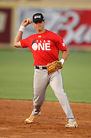 Outfielder/Shortstop Carlos Garmendia (9), who is home schooled and committed to Miami, participates in the Team One Futures Game East at Roger Dean Stadium in Jupiter, Florida September 25, 2010..  Photo By Mike Janes/Four Seam Images