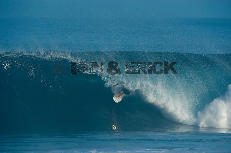 Unknown surfer (JPN0 at Backdoor on the Northshore of Oahu in Hawaii.
