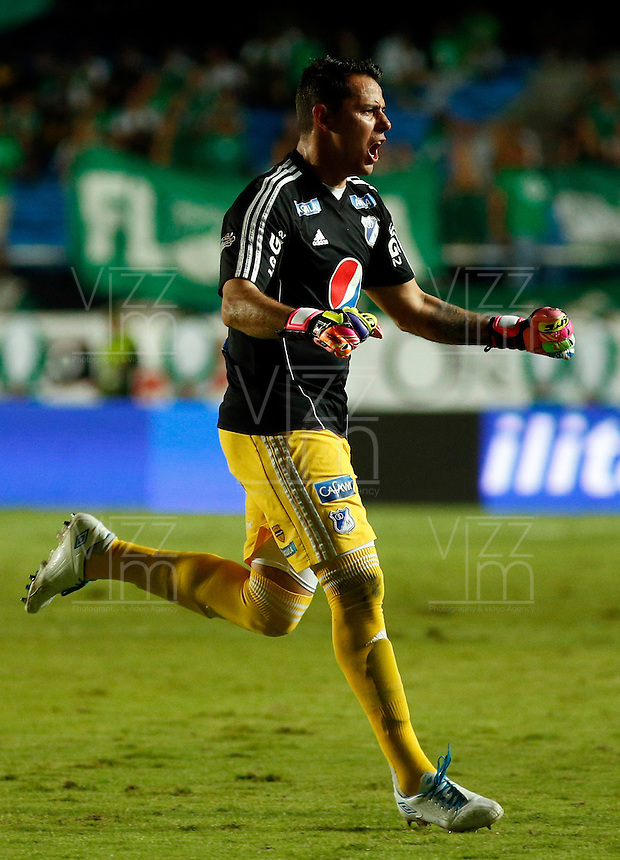 CALI - COLOMBIA -20-04-2014: Luis Delgado, jugador de Millonarios celebra el gol anotado a Deportivo Cali durante  partido Deportivo Cali y Millonarios por la fecha 15 de la Liga Postobon II 2014 en el estadio Pascual Guerrero de la ciudad de Cali.  / Luis Delgado, player of Millonarios celebrates a scored goal to Deportivo Cali during a match between Deportivo Cali and Millonarios for the date 15th of the Liga Postobon II 2014 at the Pascual Guerrero stadium in Cali city. Photo: VizzorImage / Juan C Quintero / Str.