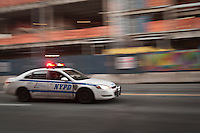 A New York Police Department car drives through the New York City borough of Brooklyn, NY, Monday August 1, 2011.