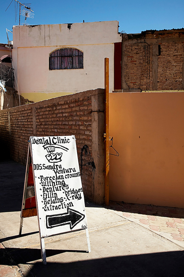 Sign pointing to dentist's office, Los Algodones, B.C, Mexico.
