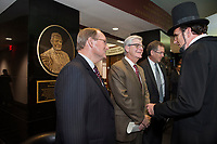 MSU President Mark E. Keenum, left, and Mississippi Gov. Phil Bryant talk with an Abraham Lincoln impersonator during Thursday&rsquo;s [Nov. 30] grand opening celebration of Mississippi State&rsquo;s $10 million addition to Mitchell Memorial Library, home of the Ulysses S. Grant Presidential Library and the prestigious Frank J. and Virginia Williams Collection of Lincolniana. <br />  (photo by Megan Bean / &copy; Mississippi State University)