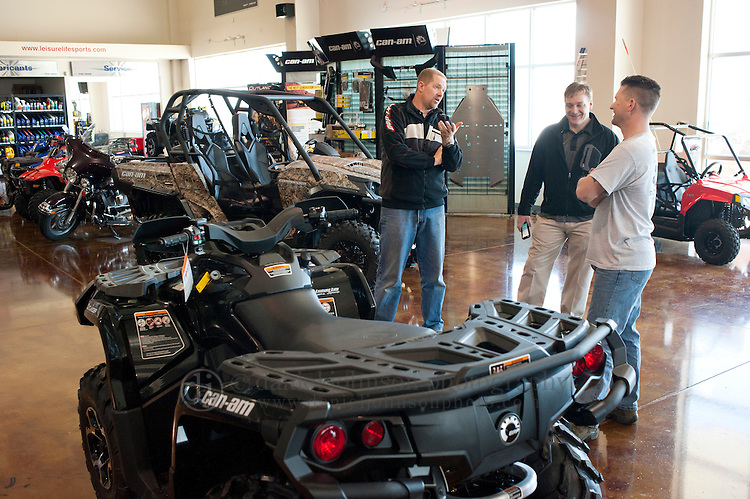 16 February 2012 --  Can-Am ATV Giveaway. Jason Moore of Omaha, right, talks Bob Smith of Leisure Life Sports, left, and BRP Sales Representative Aaron Clayton, center, as Moore picks up his Can-Am ATV that he won as prize in Can-Am 4x4x4x4 Sweepstakes. Moore picked up his ATV at Leisure Life Sports in Omaha, Neb.. Picture by Daniel Johnson (Copyright 2012 Daniel Johnson)