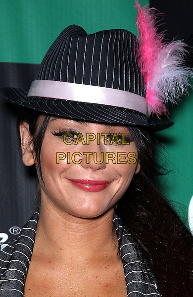 "Jenni ""JWOWW"" Farley.Jenni ""JWOWW"" Farley walks the red carpet  for ""Pimp N Ho"" themed bash at Chateau Nightclub & Gardens inside Paris Las Vegas, Las Vegas, Nevada, USA, 28th October 2011..portrait headshot hat  grey gray pinstripe dress hat trilby pink feather make-up .CAP/ADM/MJT.© MJT/AdMedia/Capital Pictures."