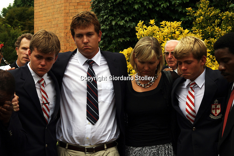 BALGOWAN, KWAZULU-NATAL - 1 February 2007 - The family of famed Anglo-Zulu expert David Rattray -- son Douglas, Andrew, 21, wife Nicky and son Peter - struggle to keep their composure shortly after the funeral of their father David at Michaelhouse School in the KwaZulu-Natal Midlands..Rattray's murder by six men last week at his home in Rorke's Drift has sparked outrage in South Africa, which has one of the highest crime rates in the world..Picture: Giordano Stolley/Allied Picture Press