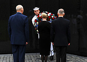 U.S. Secretary of Defense James Mattis, Cindy McCain, wife of late Senator John McCain and General John Kelly, White House Chief of Staff lay a ceremonial wreath honoring all whose lives were lost during the Vietnam War at the Vietnam Veterans Memorial in Washington, U.S., September 1, 2018.     <br /> Credit: Mary F. Calvert / Pool via CNP