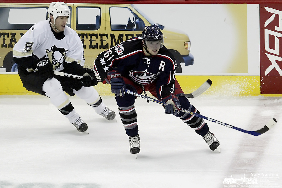 11 January 2006: Columbus Blue Jackets' Rick Nash plays against Pittsburgh Penguins' Rob Scuderi at Nationwide Arena in Columbus, Ohio.<br />