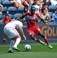 Chicago forward Dominic Oduro (8) makes a move against New York defender Carlos Mendes (44).  The Chicago Fire tied the New York Red Bulls 1-1 at Toyota Park in Bridgeview, IL on June 26, 2011.